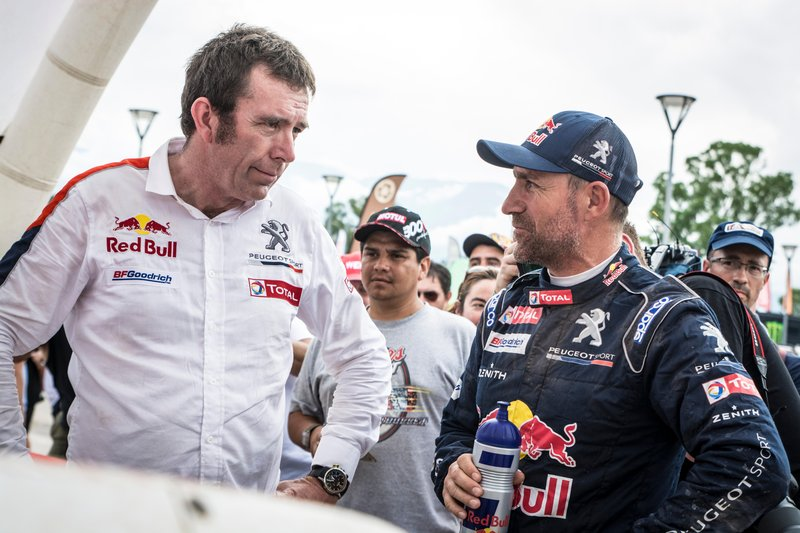 Stephane Peterhansel (FRA) of Team Peugeot TOTAL seen talking to team manager after his first win of Dakar 2017 in   San Salvador de Jujuy, Argentina on January 4, 2017